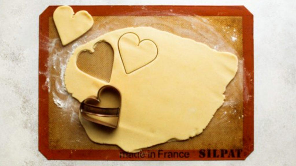 valentine day sugar cookies cutting